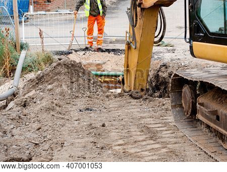 Groundworker Is Installing Internal Drainage For A House