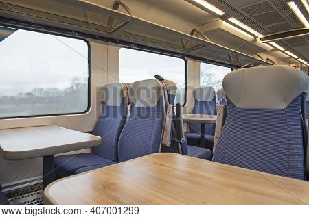 Interior Of An Empty Commuter Train Carriage With Seats