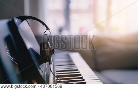 Soft Focus Digital Piano Keyboard With Headphones For Music With Blurry Of Sofa Background, Cosy Cin