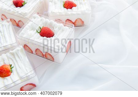 Strawberry Shortcake In Plastic Box On With Cloth Background And Copy Space, Minimal Cake And Bakery