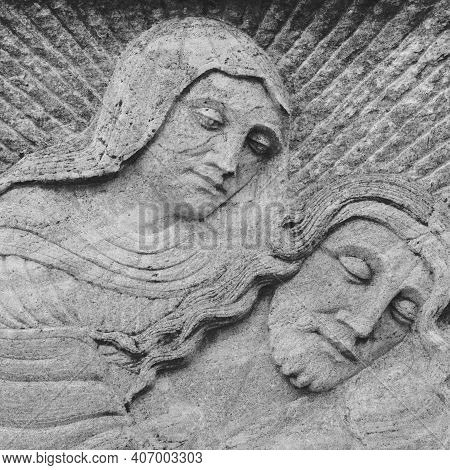 Ancient Bas-relief Of Virgin Mary And Jesus. It Can Be Used As Concepts And Events.