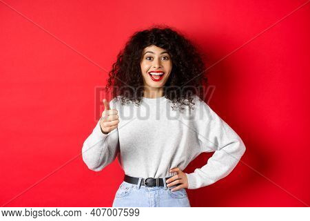 Happy Young Woman With Curly Hair Praising Good Work, Say Well Done And Show Thumb Up Gesture, Appro