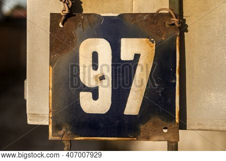 Weathered Grunge Square Metal Enameled Plate Of Number Of Street Address With Number 97