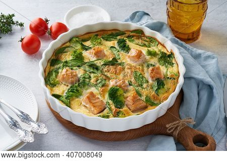 Egg-based Frittata, Omelette With Salmon, Broccoli And Spinach. Italian Dish, Crustless Quiche With