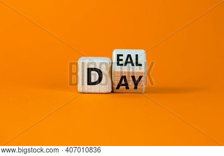 Deal Of The Day Symbol. Turned A Cube And Changed The Word 'day' To 'deal'. Beautiful Orange Backgro