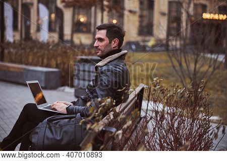Relaxed Stubbled Man Using Laptop In Park