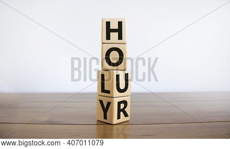 Holy Hour Symbol. Turned Wooden Cubes With Words Holy Hour. Beautiful Wooden Table, White Background