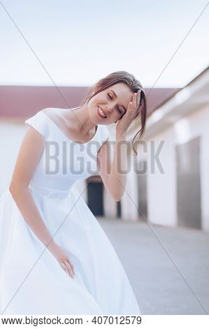 Stock Photo - Fashion Photo Of Gorgeous Bride In Luxurious Wedding Dress Posing At Bedroom. Morning