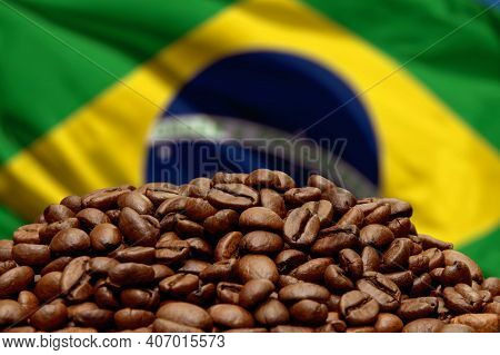 Roasted Coffee Beans On The Background Of The Brazilian Flag, Close-up, Selective Focus. Concept: Be