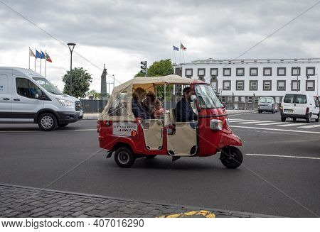 Funchal, Madeira, Portugal - April 23, 2018: Tourist Electric Vehicle Transporting Tourists In Funch