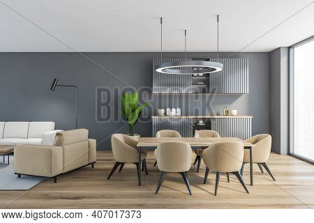 Grey Living Room With Kitchen Set And Dining Table, Kitchen Shelves With Dishes, Parquet Floor. Open