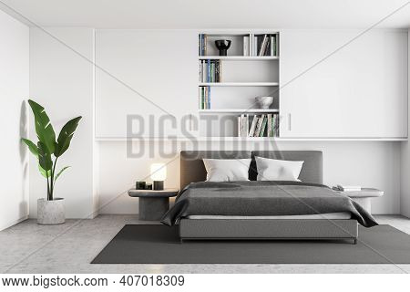 White And Grey Bedroom With Bed And Linens On Carpet. Bookshelf In The Wall, Plant In The Corner. Ma