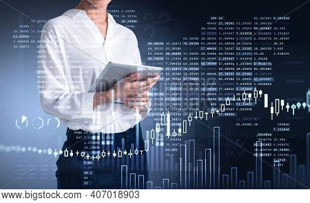 Businesswoman Trader Using Tablet To Update Stock Rates To Forecast Market Behaviour Based On Worldw