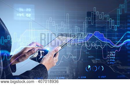 Business Woman Hand Using Tablet With Stock Market Report Hologram And Analytics. Business And Finan