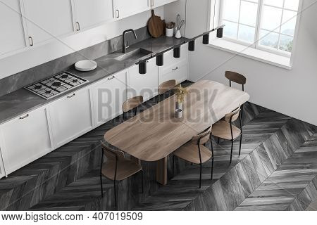 Top View Of White Kitchen Room With Wooden Eating Table And Chairs. White Kitchen Set And Window, Bl