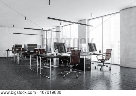 Office Room With Armchairs And Computers On The Tables Near Windows, Side View. Light Grey Office Ro