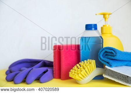 Set Of Plastic Bottles Of Different Cleaning Procucts, Rubber Gloves And Sponges On White Background