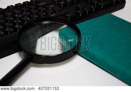 Magnifier, Green Notepad, Keyboard Lie On A White Background. Financial Items. Office. High Quality