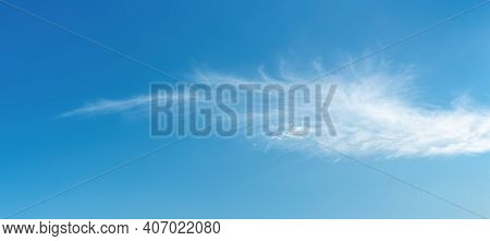 Angel Wing Shaped Cloud Against Azure Heaven. White Cloud Like A Swan Wing High In A Blue Sky. Trans