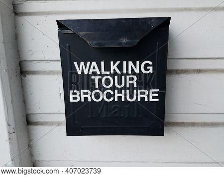Walking Tour Brochure Sign On Black Metal Box