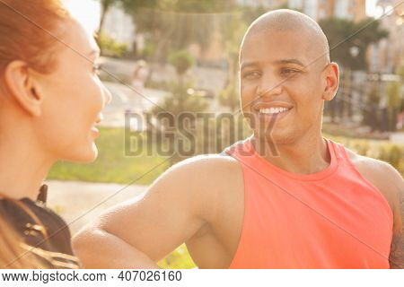 Cropped Close Up Of A Handsome African Man Smiling Joyfully, Enjoying Resting Outdoors With His Girl
