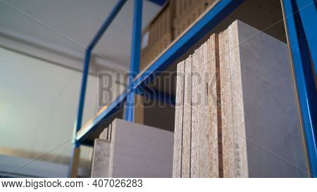 Plywood Sheets On The Shelves In The Factory Floor. Sheets In The Warehouse For The Production Of Fu