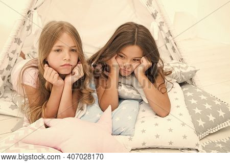 We Dont Want To Go To Bed. Unhappy Children Lie On Bed Cushions. Home Accessories. Bed Time Routine.