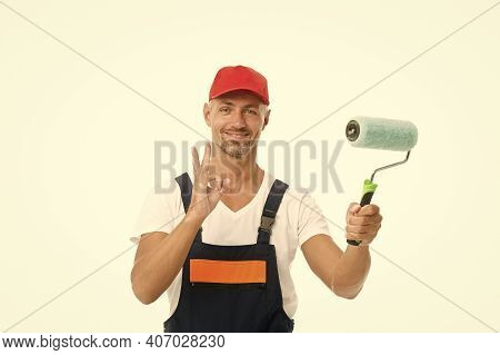 Offering Professional Painting Services. Painter Show Ok Sign Isolated On White. Color Man Hold Pain