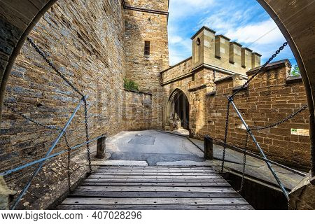 Hohenzollern Castle Entrance, Germany, Europe. This Castle On Mountain Top Is Famous Landmark In Stu