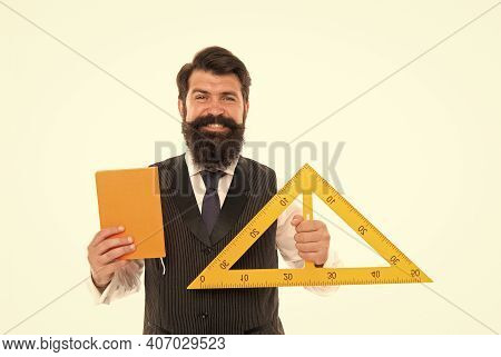 Teaching Dimension In School. School Teacher Hold Triangle And Book Isolated On White. Bearded Man R