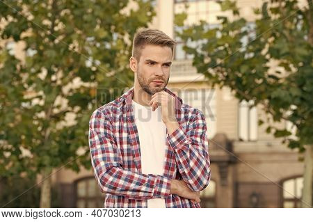 More Attractive With Beard. Serious Man Touch Beard Urban Outdoor. Unshaven Guy With Stubble Beard A