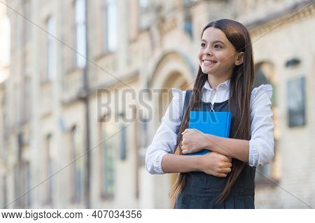 Happy Small Kid With Smart Look Wear School Uniform Holding Study Book Outdoors, Library, Copy Space