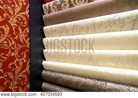 Rolls Of Vinyl Wallpaper In A Building Supermarket, Store, Market. Dense Gray, Beige, Red Wallpaper