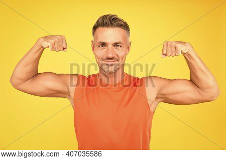 Train Hard Be Strong. Strong Man Flex Arms Yellow Background. Building Strong Biceps And Triceps. Ha
