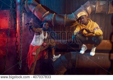 Serious rappers, break-dance performing in studio