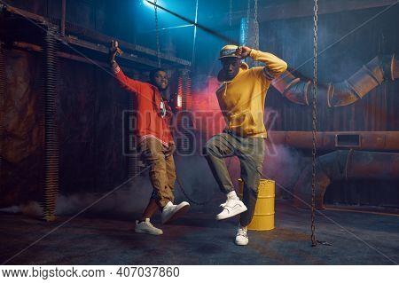 Two stylish rappers, breakdancing in studio