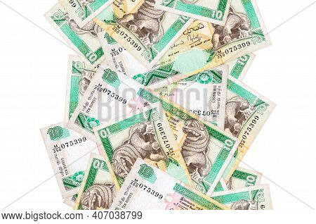 10 Sri Lankan Rupees Bills Flying Down Isolated On White. Many Banknotes Falling With White Copy Spa