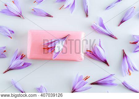Saffron Flowers On A White Background And Cosmetic Saffron Soap.