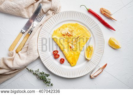 Thai  Asian Omelette, Fresh Red Chilli, Brown And White Crabmeat, Lemon, Cheddar Cheese And Eggs, On