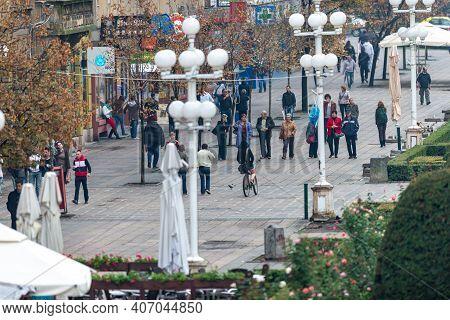 Timisoara, Romania - October 13, 2012: People Walking On The Street. Real People.