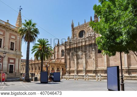 Archive Of The Indies (archivo General De Indias) And Seville Cathedral On Triumph Square, Spain