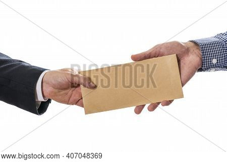 Man Giving Bribe Money In Brown Envelope To Another Businessman In Corruption Scam. Closeup Of Hands