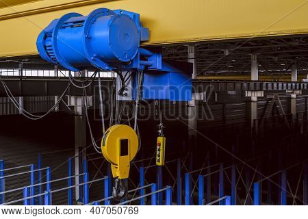 Overhead Traveling Cathead With Steel Hooks In The Factory Floor