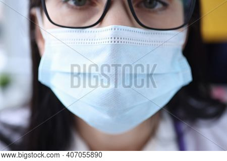 Portrait Of Woman In Protective Medical Mask And Glasses. Mandatory Mask Mode Concept