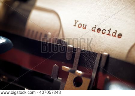 You decide phrase written with a typewriter.