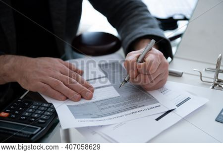 Man Sign Document With Bankruptcy Letters. Bankruptcy Notification.