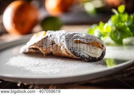 Sicilian Cannoli Sweet Dessert Topped With Sugar Served On A Plate.