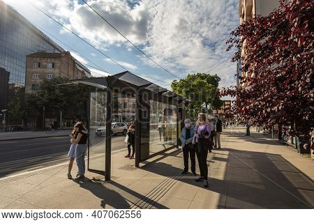 Belgrade, Serbia - May 23, 2020: Crowd Of Persons, Young And Old, Men And Women, Waiting A Bus At A