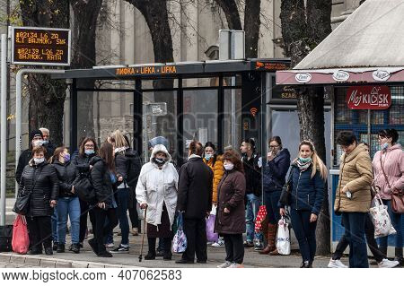 Subotica, Serbia - November 18, 2021: Crowd Of Persons, Young And Old, Men And Women, Waiting A Bus