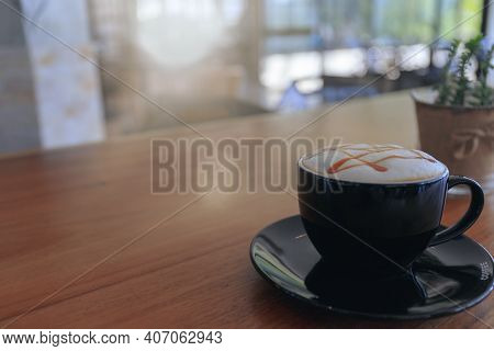 Close Up Hot Cappuccino, Latte, Caramel Macchiato On Table With Blur Coffee Shop Background. Process